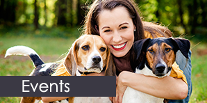 Woman Hugging Dogs - Dog Training Services